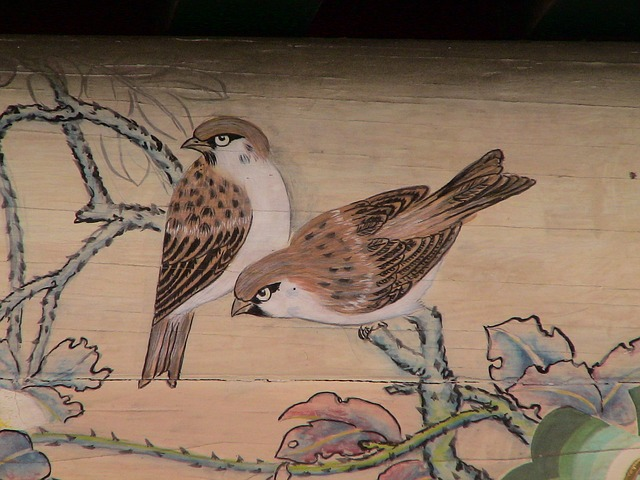 painting on a ceiling of 2 sparrows sitting on a on a branch